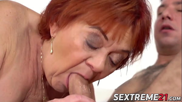 Grandma ends up with a hot facial after riding young cock