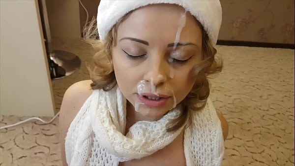 Christmas blowjob with a massive cumshot on her beautiful face