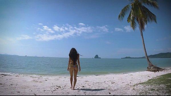 Micro bikini tease by sexy teen who walks on a beach