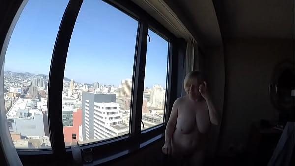 MarieRocks naked overlooking the city Thumb