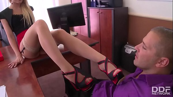 Extremely horny secretary in stockings gives a perfect footjob Thumb