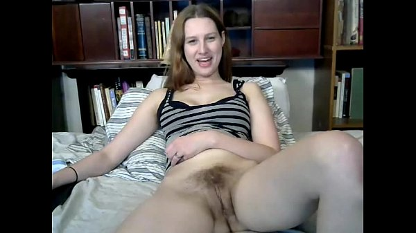 Busty cutie toys her hairy pussy on webcam