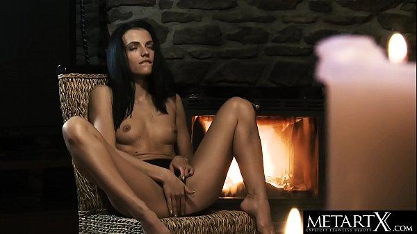 Naked beauty with perfect body masturbates to a...