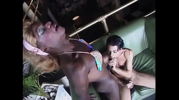 Black transvestite fucks heavily white guy