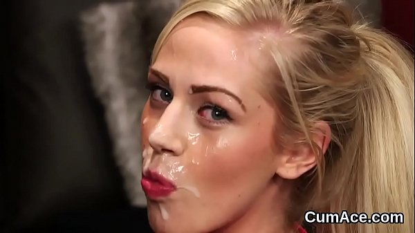 Foxy peach gets cumshot on her face eating all the cream