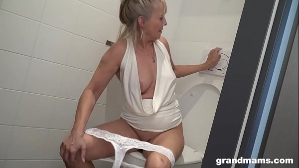 Blonde granny puts toilet brush up young boys asshole Thumb
