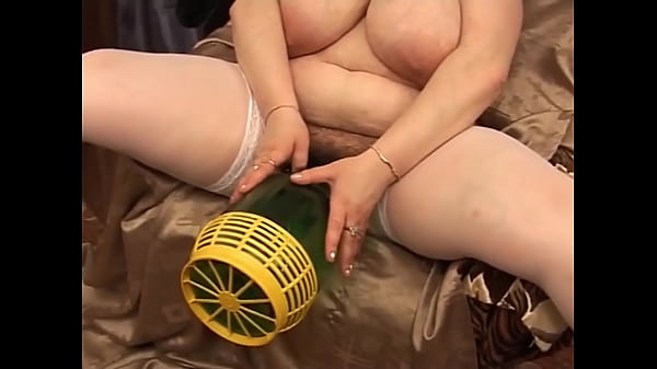 d. mom trying to push in a huge bottle in her cunt - FreeMatureCameras.com Thumb