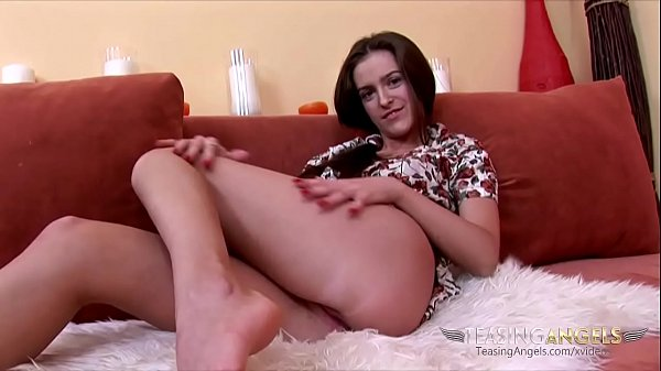 Jenya spreads her sexy legs and hikes up her dress, wearing no panties