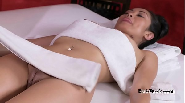 Masseuse rubs Asian babe with her body
