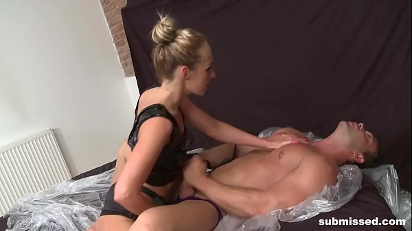 Blonde Dominatrix Babe submisses Guy and he likes it Thumb