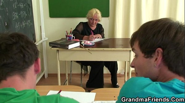 Two lucky studs have fun with old teacher