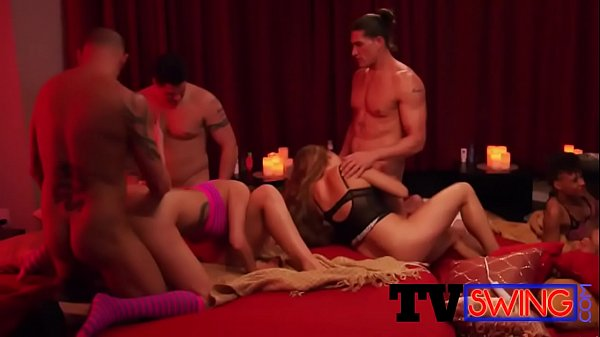 A red hot room full of naked couples