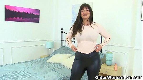 British milf Lelani fucks huge dildo in leggings