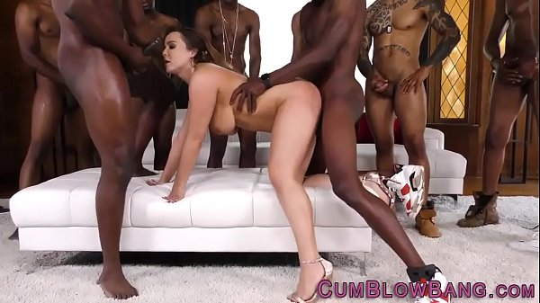 Busty slut gives blowbang to bbcs