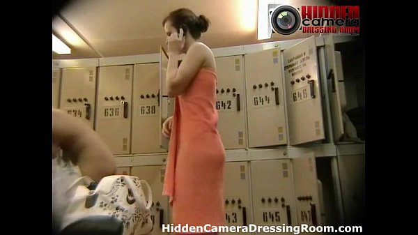 Voyeur cam catches unaware milf dressing