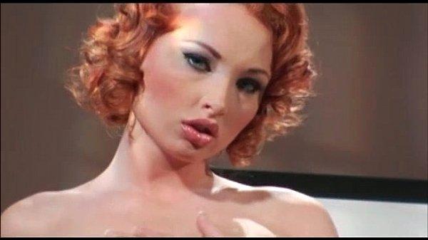 Curly redhead bitch takes two big cocks Thumb