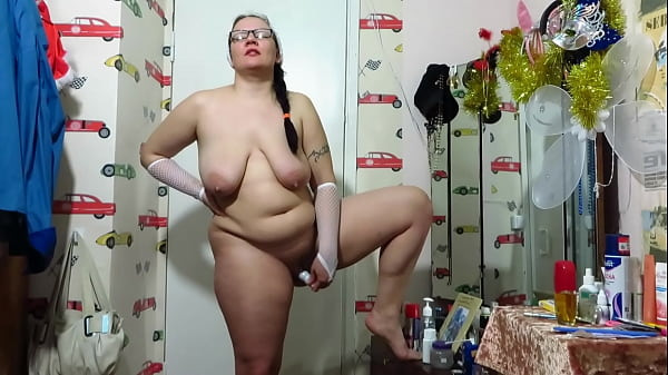 Chubby milf masturbates her shaved pussy with bottles with a comb, with a dildo and shakes her big tits Homemade fetish