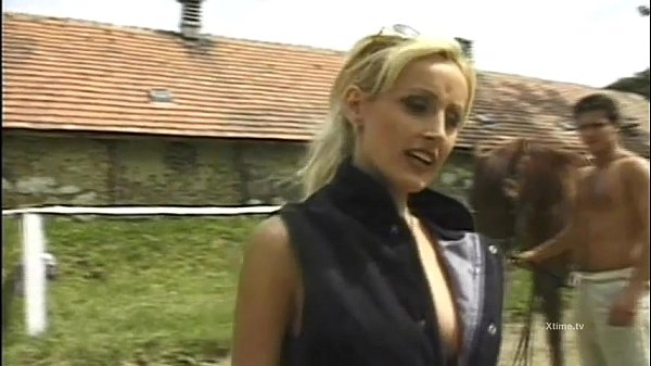 Blonde slut gives blowjobs on a stable