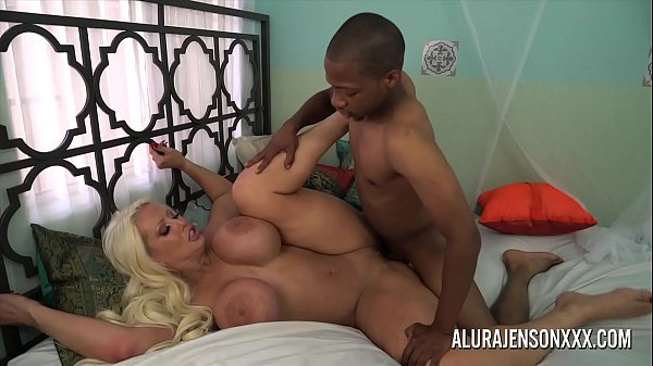 Alura Jenson jerks off a black cock with her feet Thumb