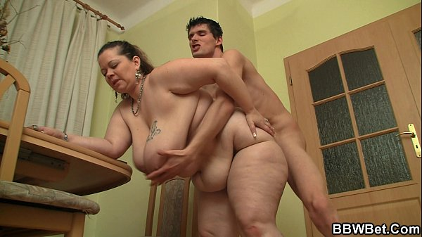 Bigcocked guy bangs big belly plumper from behind