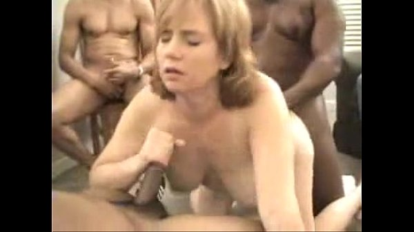 Image Redhead Dawn in an interracial creampie gangbang
