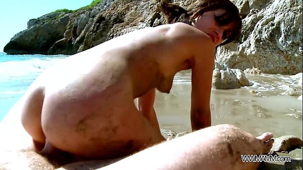 Ponytailed young brunette enjoy sensual sex on the beach