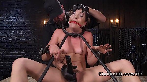 Gagged brunette slave hard flogged