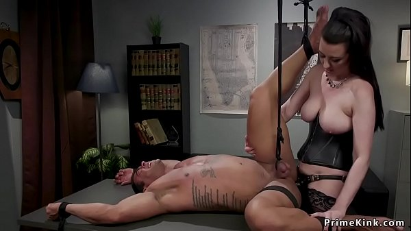 Dominant boss spanks male employee