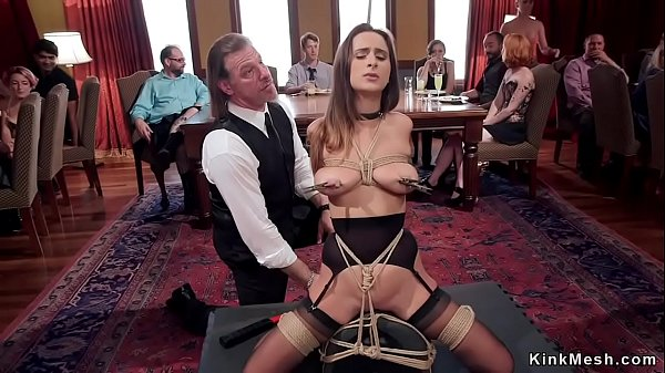 Busty tied up brunette slave at orgy