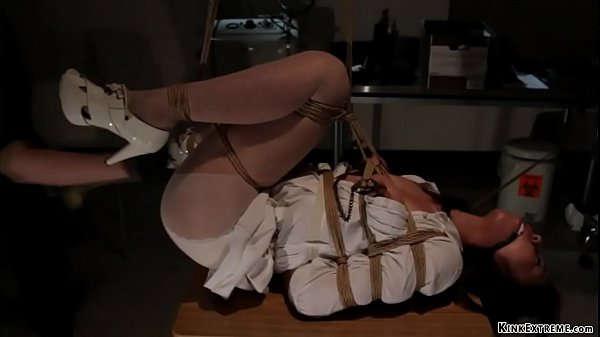 Brunette fists Asian in rope bondage Thumb