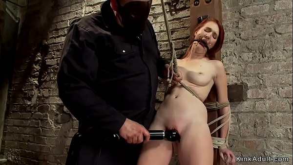 Redhead tied and suspended on hogtie