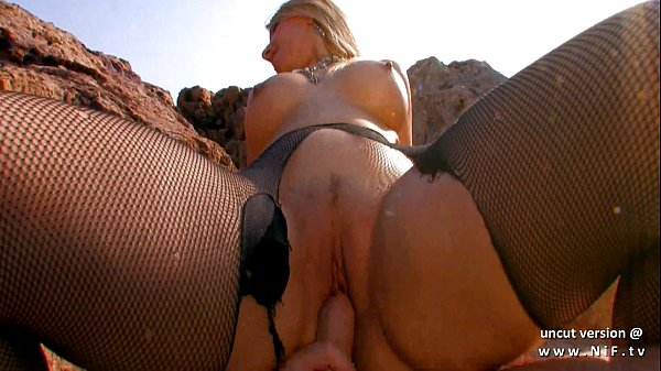 Busty blonde whore with big ass banged hard and facialized on a beach