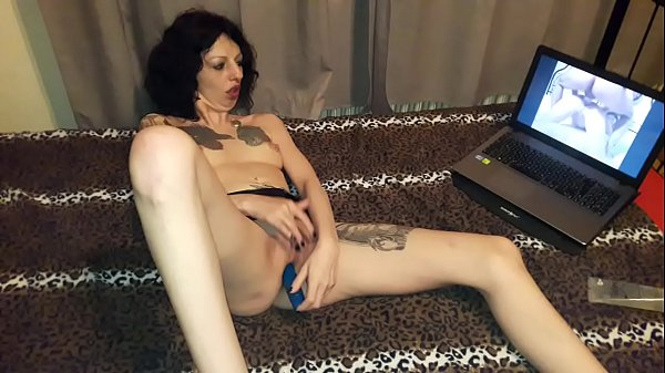Slut Lucy Ravenblood masturbating with a vibrator while  watching a porn movie Thumb