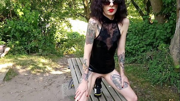 Huge bottle ride and fistfucking horny slut in a public park Thumb