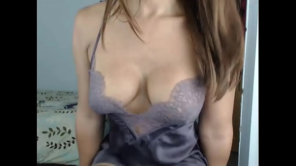 Brunette with big tits in a nightie on cam