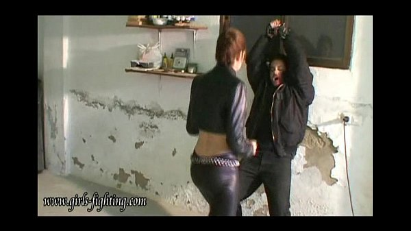 girl in leather pants kick a guy 00