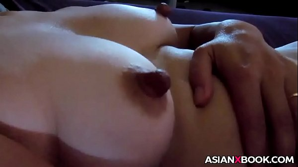 Asian MILF masturbates to orgasm