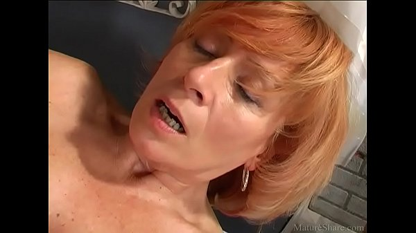 Attractive granny pleasing her pussy with a new sex toy