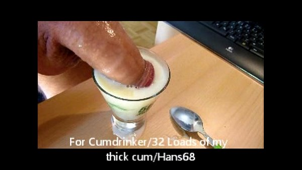 Filling a cup with cum