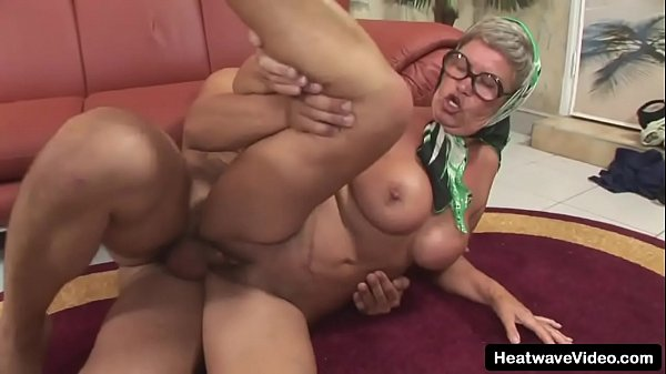 Older woman has huge tits and a love of hard cock as she fucks the young photographer Thumb