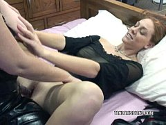 Redhead Mariah takes a strapon from a mature slut