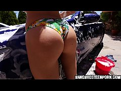 Sexy teen washing a sportscar