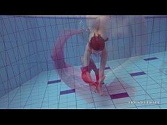 Redhead in the pool