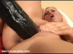 Kathy drilling her pussy hole with two massive brutal dildos