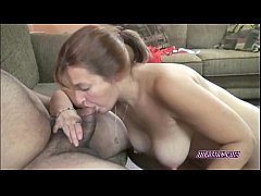 Redhead Liisa on her knees and swallowing a cock