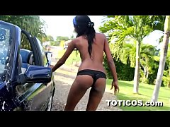 Topless Dominican teen Barbie washes Volkswagen...