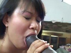 Big black dick penetrates deep inside Asian Kiw...