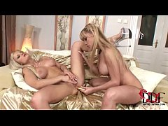 Hot young lesbian blondes kissing and loving ea...