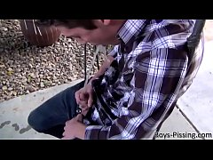 Twink Riley Michaels jerks off in his backyard after pissing