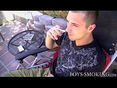 Handsome cutie JD Phoenix smoking during outdoor solo